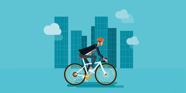 employee-riding-bicycle-through-city