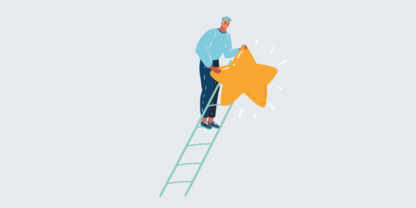 man-on-ladder-placing-star