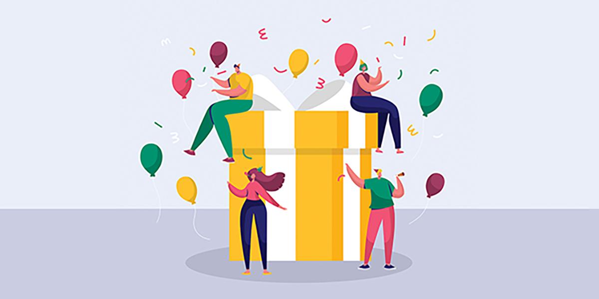 team-celebrating-around-birthday-present-3